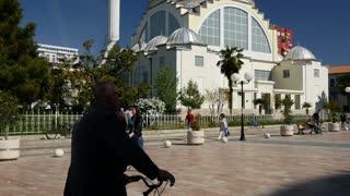 Tilt up from the Ebu Beker Mosque to the road in Shkodër Albania