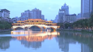 Time lapse from day to night of the Anshun Bridge at night