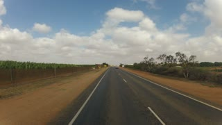 Time lapse from driving through little coastal town and moving on at a long flat landscape road in Western Australia