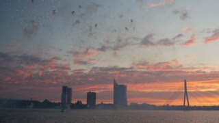 Time lapse from fireworks during sunset in Riga with the Vanšu Bridge in Latvia