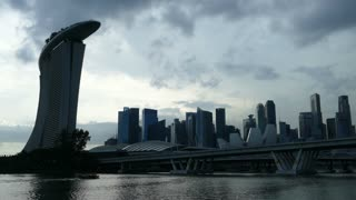 Time lapse from Hotel and casino, Marina Bay Sands and skyline at a cloudy day in Singapore