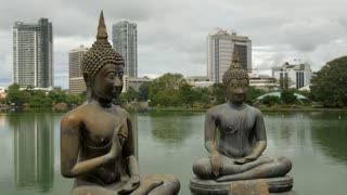 Time lapse from the Buddhism statues at the Simamalaka shrine, on an island in Beira Lake, Colombo, Sri Lanka