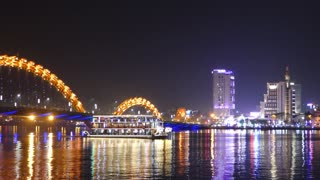 Time lapse from the Dragon bridge with cruise ships in the evening in Da Nang, Vietnam