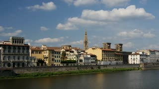 Time lapse from the Fiume Arno river and clouds above Florence Italy