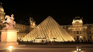 Time lapse from the Louvre at night with statue