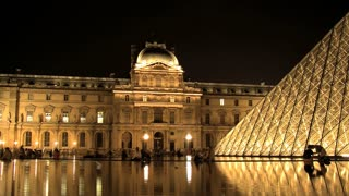Time lapse from the Louvre at night with water reflection