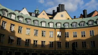 Time lapse of a circle of houses in Gamla Stan Old Town Stockholm Sweden