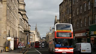 Time lapse of busses and other traffic driving in the old town of Edinburgh Scotland