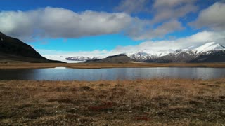 Time lapse slide from mountains with reflection in a pond at southeast Iceland