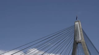 Top of the The ANZAC Bridge in Sydney with the Australian flag