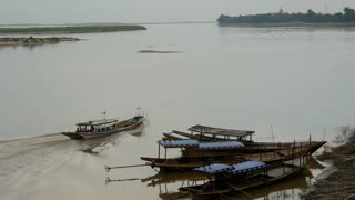 Tourism and fishing boats at the Irrawaddy river in Bagan, Myanmar, Burma