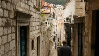 Tourist man walking through the streets of Dubrovnik Croatia