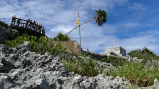 Tourists at the ancient Mayan fortress in Tulum Yucatan, Mexico