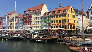 Tourists in a boat arriving in Nyhavn (New Harbour) in Copenhagen Denmark