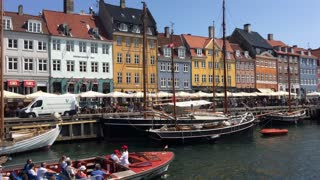 Tourists in a boat leaving Nyhavn (New Harbour) in Copenhagen Denmark