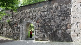 Tourists walking at the Akershus Fortress in oslo Norway