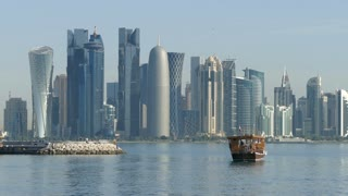 Traditional Dhow, Arab sailing vessel in front of the Doha skyline