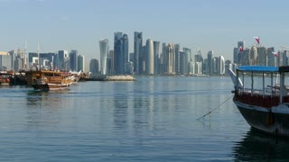 Traditional Dhow, Arab sailing vessel in the morning leaving Dhow Harbour in Doha Qatar
