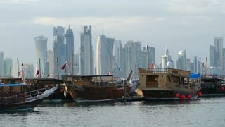 Traditional Dhow, Arab sailing vessel leaving Dhow Harbour in Doha Qatar