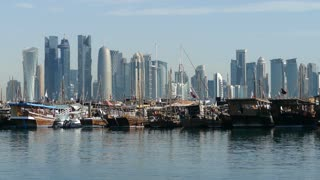 Traditional Dhow, Arab sailing vessels in Dhow Harbour and Doha skyline in the morning