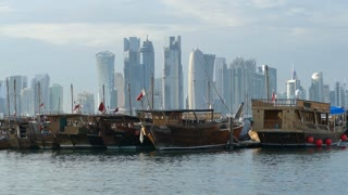 Traditional Dhow, Arab sailing vessels in the Dhow Harbour with the Doha skyline in the background