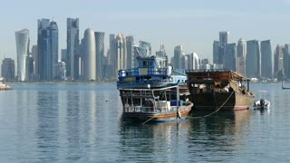 Traditional Dhow, Arab sailing vessels in the morning with the Doha skyline in the background in Qatar