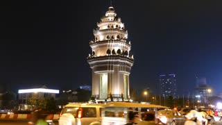 Traffic around the Independence Monument at night in Phnom Penh Cambodia