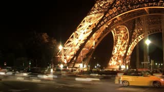 Traffic at night in front of the Eiffel tower timelapse Paris, France