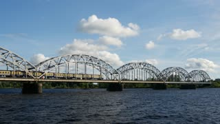 Train driving over the Railway Bridge in Riga Latvia