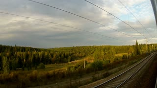 Trans-Siberian Railway train driving thought the forest