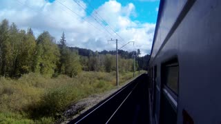Trans-Siberian Railway train passing by a landscape with forest