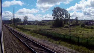 Trans-Siberian Railway train passing by other train and station