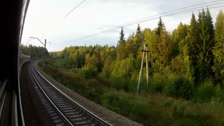 Trans-Siberian Railway train view from the back and forest