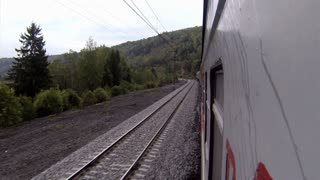 Trans-Siberian Railway train view in a curve with mountains