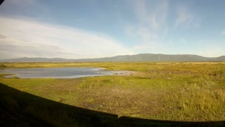 Trans-Siberian Railway train with siberian landscape and lake