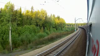 Two Trans-Siberian Railway trains passing by each other in a sharp corner with high speed