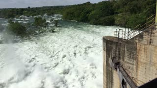 Udawalawe Dam with all four spillways open creating a big stream of water in Sri lanka