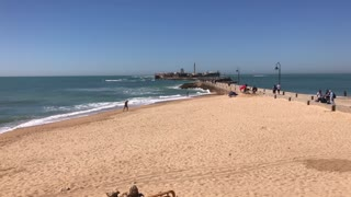 Beach in front of Castle of San Sebastian in Cadiz Spain