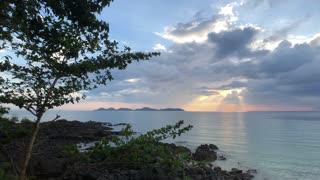 Cloudy sunset on Farang Beach in Koh Mook Thailand