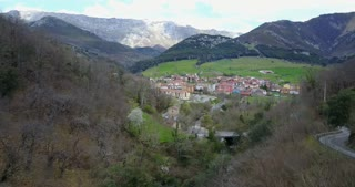 Flying towards a village at Picos de Europa in Spain