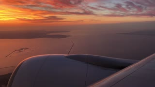 Sunset flying over the IJsselmeer towards Schiphol Airport in Amsterdam The Netherlands