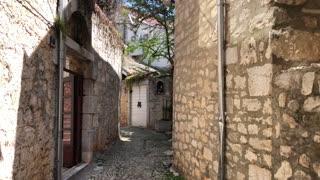 Walking through the old town of Supetar on the island Brač, Croatia