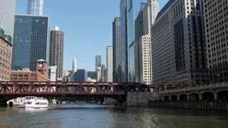 View from the Chicago river passing by a bridge