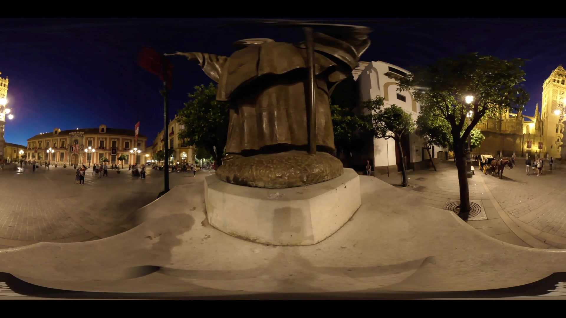 Virtual Reality 360 view from the Cathedral of Saint Mary of the See (Seville Cathedral) next to the pope statue at night in Seville Spain