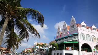 Walking in front of the colorful Royal Plaza Mall in Oranjestad Aruba