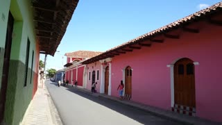 Walking through the streets of Granada Nicaragua with colorful houses
