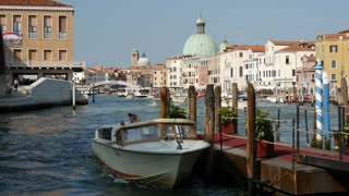 Water taxi at the pier at the canal grande in Venice Italy