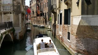 Water taxi in a canal in Venice Italy
