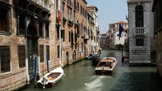 Water taxi passing by a gondola in Venice Italy
