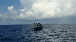 Whale watching boat at sea in Sri Lanka